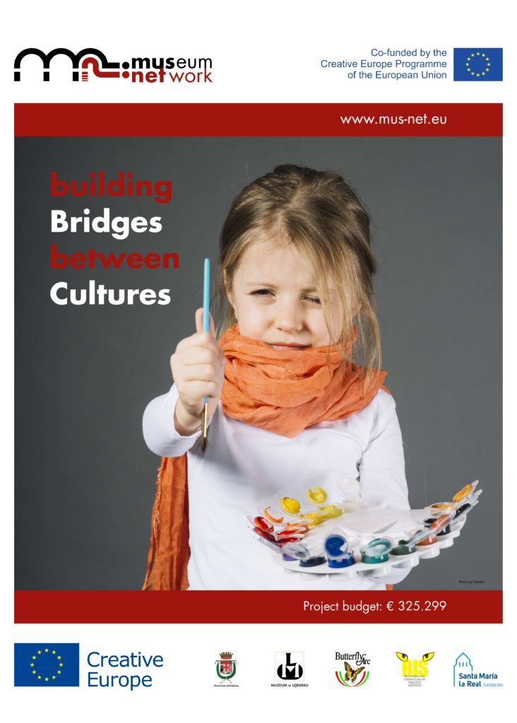 Poster displaying the body from waist to head of a young girl holding a brush on one hand and a colour tray on the other. Beside her the claim of the project: Building Bridges between Cultures